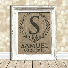 Custom monogramed burlap art print features your little one's initial inside a laurel wreath, along with their name and birthday.