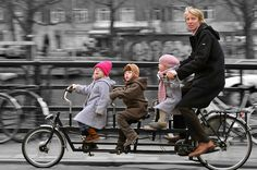 Amsterdam bike train. Kids look so cute and happy out with their Dad. Not bored and fractious like in the back seat of a car. This is so much healthier.