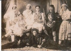 "Aromanians or Vlachs from the Balkans. These are called ""armatoles"", They used to fight against greeks at that time. They were dressed for carnival, their costumes were a bride and priest like outfit. Anyway details from their costume, could be found in their way of dressing for fight. They wore gold jewels on chest, wigs not to be recognized by the enemy..a whole ritual!"