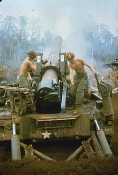 American gunners of B Bty 6 Bn 27 Artillery fire a M-110 8 inch howitzer during a fire support mission at Landing Zone Hong approx 12 km north east of Song Be South Vietnam 26 March 1970