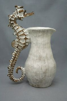 Seahorse Pitcher by Shayne Greco. This Seahorse Pitcher is handmade using a coil technique and free-form hand sculpting. The pitcher is formed from the layering of multiple Ceramic Pitcher, Ceramic Clay, Porcelain Ceramics, Ceramic Pottery, Pottery Art, Fine Porcelain, Pottery Sculpture, Slab Pottery, Thrown Pottery