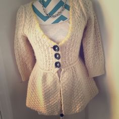 Free People Sweater Adorable peplum style wool sweater. 3 large buttons in front with yellow stitching around collar. 3/4 sleeves. Minimal pilling and in great condition. Made with wool and acrylic material. Free People Sweaters