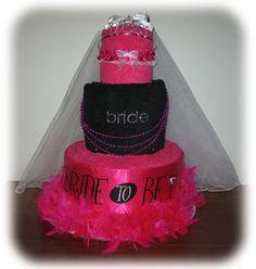 "Its a ""Bachelorette Cake"".  Beach towels, bride tank top"