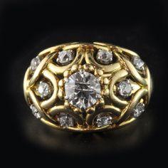 18ct Yellow Gold Bombé-Style Ring in an open-work design diamond-set through-out with a central old-European cut diamond by René Boivin, Paris circa 1935's