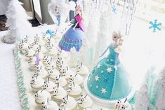 Elsa and Anna cakes with Olaf cupcakes at a Frozen girl birthday party! See more party ideas at CatchMyParty.com!