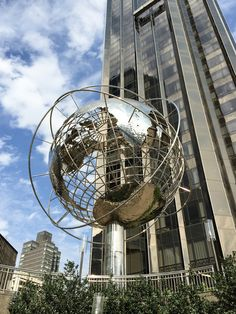 steel world globe sculpture by Kim Brandell in front of Trump Hotel in Columbus Circle