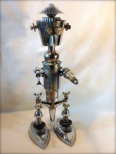 Chromator. H : 70 cm. robot métal recyclé, fers à repasser, robinet, cafetière, roulements... # sculpture # robot # métal recycled # pistolet laser #