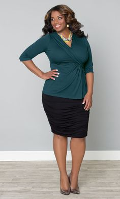 Our plus size Katniss Knit Top is a great option for work.  The modest neckline lets you cover up without feeling suffocated and the soft, jersey knit keeps you comfortable all long.  Pair with a classic pencil skirt and pumps and VOILA!  www.kiyonna.com  #KiyonnaPlusYou  #Plussize  #MadeintheUSA  #Kiyonna  #WorkAttire