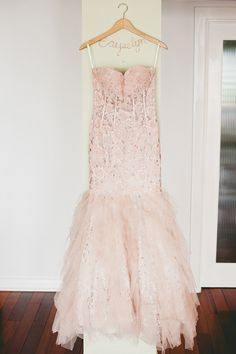 blush pink wedding gown, photo by Onelove Photography http://ruffledblog.com/romantic-wedding-handcrafted-by-the-groom #weddingdress #bridal #fashion