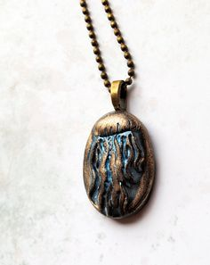 Jelly fish pendant hand pulled blue warm bronze by studiotambria, $15.00