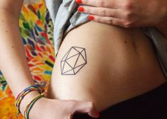 fuckyeahtattoos:    Icosahedron - one of the five Platonic Solids and symbol for the element of water. She's a Cancer which means her element is water, and also she likes geometric / symetrical shapes.  Done by Tony at Tony Tattoo, Czech Republic.
