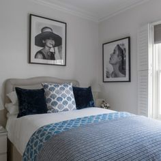 White bedroom with Hollywood star portraits and blue accents