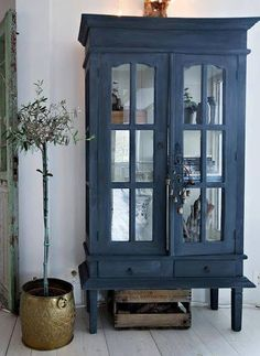 love the blue paint on this old vintage china cabinet