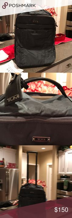 Authentic  Unisex Tumi travel rolling luggage This Roller bag larger and deeper than a backpack, perfect for that weekend getaway. Fits under the seat, no need to check it, excellent condition. Was given as a gift from NBC Emmy award show, only used one time. Completely spotless. Retails for $545 on Tumi site. Tumi Bags Luggage & Travel Bags