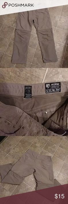 Mens KUHL Liberator Convertible Pants 36 x 30 Mens khaki KUHL Liberator Convertible Outdoor Pants. These pants can be turned into shorts with the zipper at the knee! Mens size: Waist 36. Inseam is 30. Khaki. 72% nylon 23% cotton. Pre owned. They are great but there is a corner tear on the back right leg. Could be worn as is or a simple patch would solve the problem. These are top quality pants for a low price! Kuhl Pants