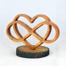 Image result for infinity wood carving