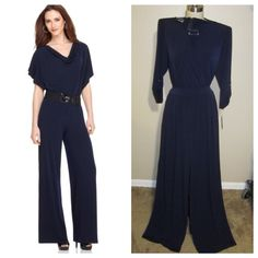 Navy jumpsuit Navy wide leg jumpsuit with cross bust, hardware at the neckline, 3/4 sleeves and pockets. NEW WITH TAGS 96% polyester 4% spandex PLEASE NOTE THE JUMPSUIT THE MODEL IS WEARING IS SIMILAR TO THE ONE FOR SALE. Dresses
