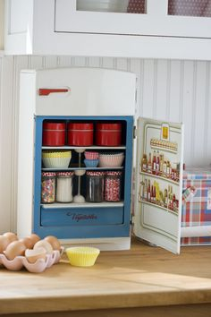 Vintage toy refrigerator as storage space! Yay, for the cutest re purposing, evah!