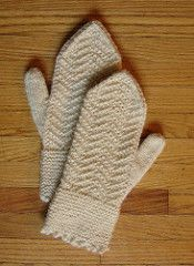 These mittens have wide and cozy garter stitch cuffs and a chevron pattern over the back of the hand, with a single garter stitch at each side. The palms and thumbs are kept in stockinette for fast and easy knitting. For best effect, choose a crisp worsted-weight wool yarn.