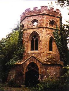 This is the Gothic Boathouse at the bottom of Gunnersbury Park West London. It is overrun with plants and crumbing.