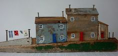 Beach cottages by Kirsty Elson of Sixty One A, created in Cornwall with driftwood and other found objects.  It's uncanny how she captures the flavor of that region with just a few details.