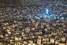 Cementerio de Obreros at night and a glowing cross, via Flickr.