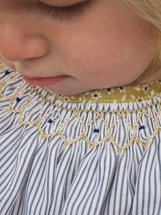 navy and mustard smocking tunic.   love the print bias band around the neck