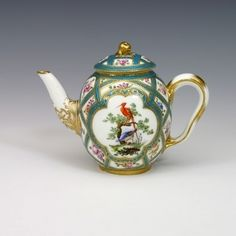 A Sèvres Teapot, circa 1758-60  This Sèvres porcelain teapot (a théière Calabre) is decorated with turquoise-blue (bleu céleste) ribbons and flowers painted in natural colours.  On either side birds are painted in the reserves, depicted in natural settings and clearly attributable to Louis-Denis Armand l'aîné.  Factory marks in blue.  The lid appears to be a later replacement.  H. 12.5cm  W.17cm  D.9.5cm  No: 9403