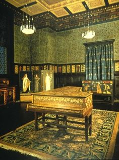 Philip Webb designed the ceiling, frieze and gesso panels on the walls •Edward Burnes-Jones painted the designs on the pianoforte •William Morris designed the wallpaper, window treatments and area rug