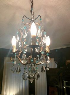 Chandelier in bedroom- added Etsy aqua crystals for color