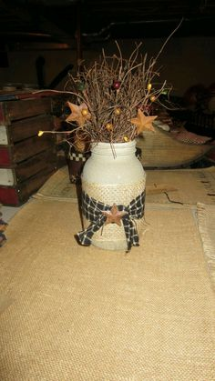- handmade by Plain View Primitives - jar is painted a beige/tan color and is a textured paint to add more dimension to this arrangement - adorned with burlap, black gingham homespun, rust stars, and Mason Jar Projects, Mason Jar Crafts, Wine Bottle Crafts, Bottle Art, Crafts To Make, Easy Crafts, Decor Crafts, Country Crafts, Country Decor