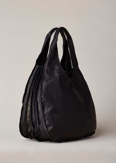Black leather shoulder bag with an accordion fold. Branded dust bag  included. Cute Tote d1dbcfcd90e7c