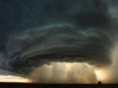 This spectacular photograph is of a supercell thunderstorm at sunset, rolling across the Montana prairie.