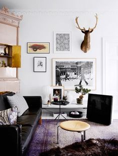 Eclectic white and neutrals living room space with gallery wall