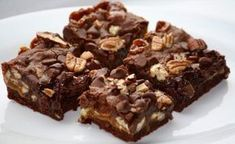 Pecan Pie Brownies bring two favorites together. Take a chocolate brownie recipe and combine it with everything we love about pecan pie, and you get this dessert-lover's dream. Oreo Candy Bar, Brownie Bar, Granola, Single Serving Recipes, Peanut Butter Filling, Chocolate Chip Banana Bread, Unsweetened Chocolate, Healthy Sweets, Stick Of Butter