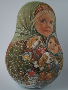I am always fond of painting portraits, trying to transmit not only the similarity,but also the character and mood that's why you can find not only joy,but also astonishment,tender emotion,pensiveness and gentleness in the faces of my nesting dolls.   eBay!
