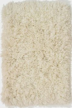 Heavy Cream Shag Rug to go over the timber floor boards in the lounge room