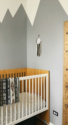 The sky's the limit with this adventurous nursery. Sydney of used a coat of Moth Grey to create this DIY mountain mural. Sydney's neutral color scheme uses natural wood accents to keep her black, white, and gray color palette feeling warm and welcoming. Nursery Modern, Rustic Nursery, White Furniture, Accent Furniture, Wood Furniture, Baby Boy Rooms, Baby Boy Nurseries, Baby Room, Nursery Paintings