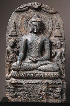 INDE Buddha Shakyamuni India, Bihar; Pala period (c.8th - 12th century), late 9th - early 10th century This image of the Buddha makes the earth-touching gesture (bhumisparsha mudra) with his right hand and the gesture of meditation with his left. Together, these two gestures signify the moment when the Buddha-to-be overcame the forces of the demon Mara and reached down to call the earth goddess (represented below holding a water pot) to witness his right to achieve enlightenment.