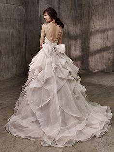 Blush oversized bow ruffled wedding gown: http://www.stylemepretty.com/2016/10/16/badgley-mischka-bridal-week-fall-2017-wedding-dresses/ Courtesy: Basgley Mischka - http://www.badgleymischka.com/