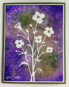 """By Patsy Collins. Tap watercolor powder (Color Burst and Magicals on this card) onto watercolor paper; spritz. Dry. Mat. Attach white die-cut """"Bella Bouquet"""" (Memory Box)."""