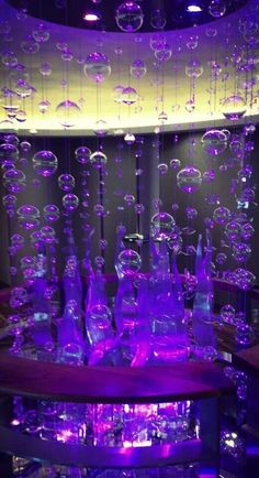 Glass bubbles... not exactly garden art, but over a pool and underlit.