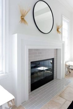 If you are looking for the best marble tile fireplace surround ideas for your house, you've come to the right place. There are many types of tile that would be perfect for your fireplace. Modern Fireplace Mantels, Fireplace Tile Surround, Brick Fireplace Makeover, Small Fireplace, Bedroom Fireplace, Farmhouse Fireplace, Home Fireplace, Fireplace Remodel, Fireplace Surrounds