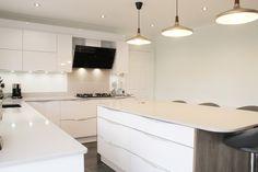 Lake View kitchen created by Simply Kitchens Plymouth. Modern kitchen, white kitchen, kitchen island, kitchen lighting.