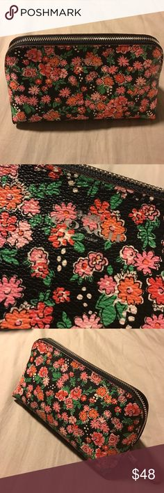 Coach pink floral cosmetic pouch Coach pink floral cosmetic pouch. Black background with all over pink floral design, front & back. Inside & zipper is a pink color, one all the way around silver zipper. One large slit pocket on one side. Coach Bags Cosmetic Bags & Cases