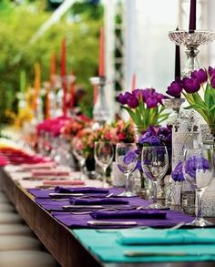 Table setting. Rainbow. Tulips. Colorful candles.