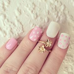 It's a simple blending of white and pink in polka dots and solids ..  that's just perfect! #nailart #naildesign #pink