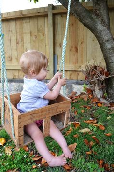 { DIY } toddler swing from a wooden crate