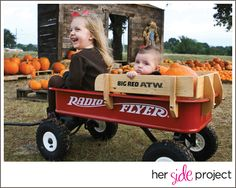 Sisters. Radio flyer. Pumpkins!