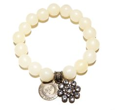 Snowflake White Love Cures Bracelet -- Off White Vintage Seed Beads create this classic Love Cures Stretch Bracelet accented with our Swarovski Snowflake Crystal Charm. -- $65.00